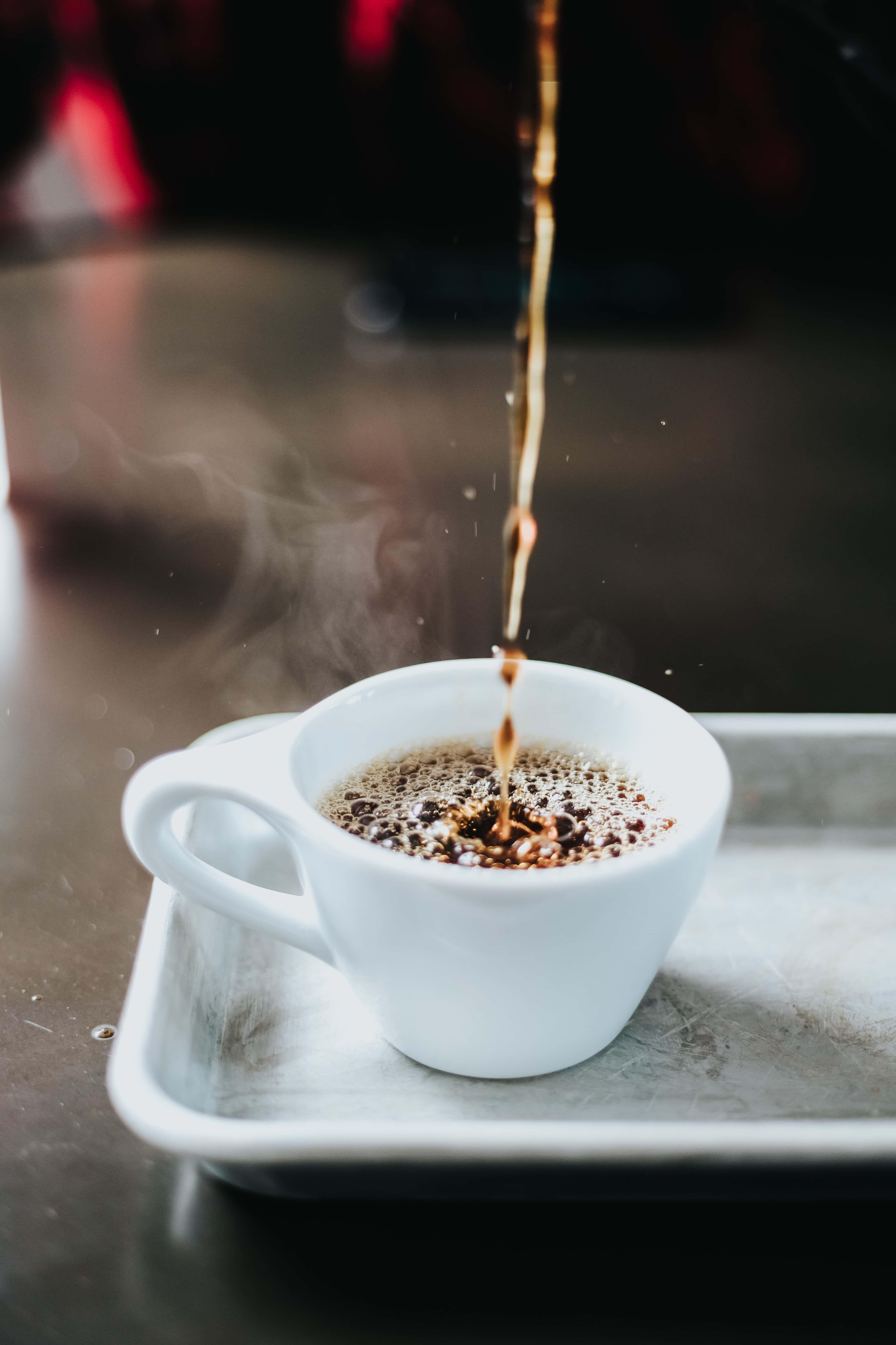 Coffee poured into a mug